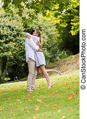 couple hugging at the park - romantic couple hugging at the...
