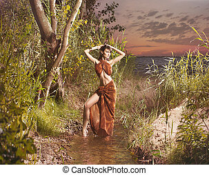 Young and beautiful tribal woman in autumn styled jungle