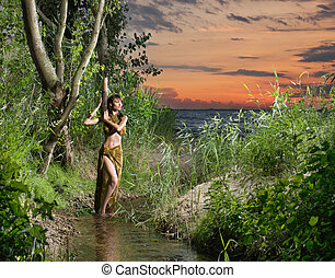 Young, beautyful and sexy savage girl in jungle