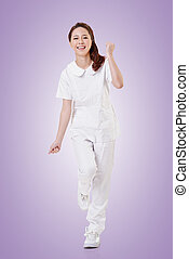 Cheerful Asian nurse, woman portrait isolated on white...
