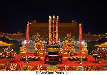 Sacrificial offering or oblation with joss stick and candle...