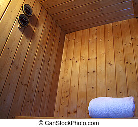 Sauna - Inside a wooden sauna, towel and controls