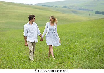 couple walking on countryside - lovely couple walking on...