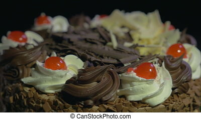 Detail of a chocolate cake spinning - 4k - Detail of a...