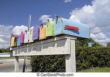 Colorful Mailboxes - A variety of colorful mailboxes are set...