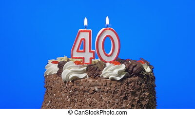 Blowing number 40 candles on a cake