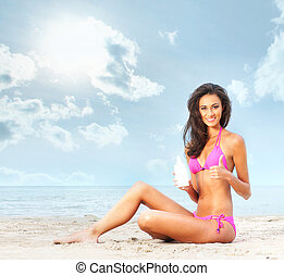 Young, beautiful, slim and sexy woman on the beach -...
