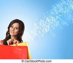 Young beautiful woman with some shopping bags isolated on...