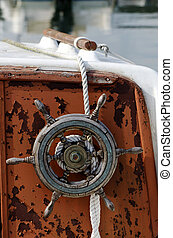 Old boat wheel - Old boat with a wood wheel on a dock