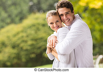 cute young couple - portrait of cute young couple hugging...