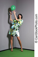 Fashion shoot of young attractive woman in retro style