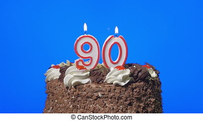 Blowing number 90 candles on a cake