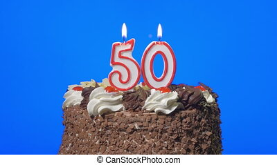 Blowing number 50 candles on a cake - 4k - Blowing out...