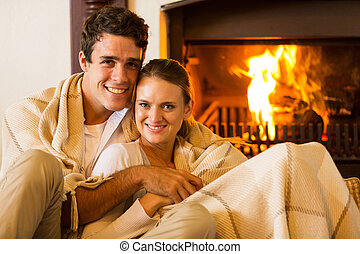 couple relaxing on the couch - happy couple relaxing on the...
