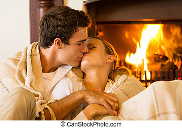 young couple kissing in living room - romantic young couple...