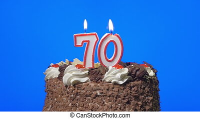 Blowing number 70 candles on a cake