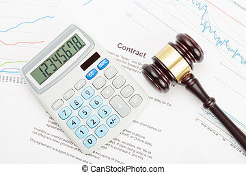 Wooden judge's gavel and calculator over contract
