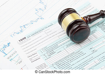 Wooden judge's gavel over 1040 US Tax form - Judge's gavel...
