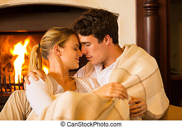 young couple in love cuddling - affectionate young couple in...