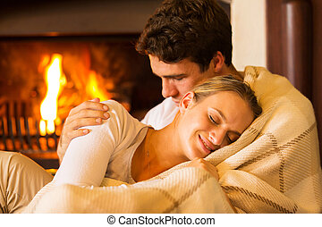 couple relaxing at home - beautiful couple relaxing at home...