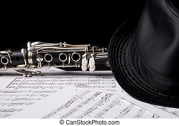 Clarinet, under a hat -  isolated over sheet music