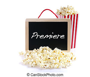 Premiere. - Popcorn and blackboard with the word Premiere.