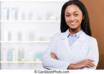 Confident pharmacist. Beautiful young African woman in lab...