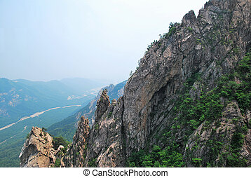 Treacherous mountain cliffs with pointed and jagged edges...