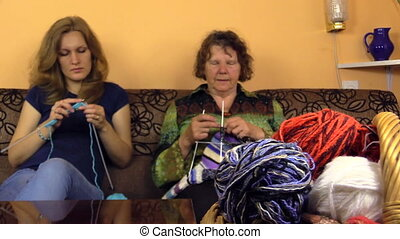knitters and wool balls - Old grandmother and young...
