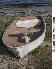 abandoned dinghy - abandoned white dinghy on northern east...