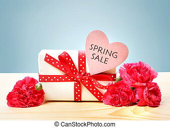 Spring Sale message with gift box and carnations