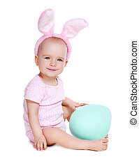 side view of a baby girl wearing rabbit ears