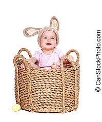 baby girl easter rabbit sitting in a basket