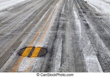 slippery icy road with yellow line - street asphalt pavement...