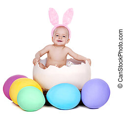 baby girl easter rabbit sitting in a giant easter egg isolated on white