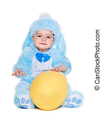 baby girl wearing rabbit fancy dress sitting on the floor