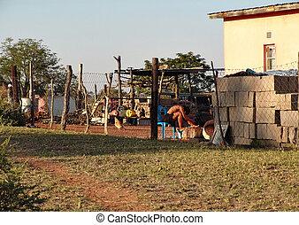Voyeur - Man watching a woman bathing in the village, people...