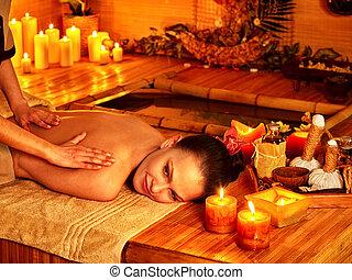 Woman getting bamboo massage. - Woman getting massage in...
