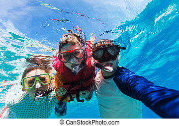 Family snorkeling - Underwater portrait of family snorkeling...