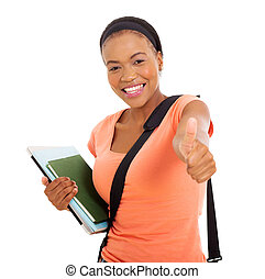 young african american college girl thumb up - happy young...