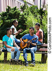 group of african american college friends having fun
