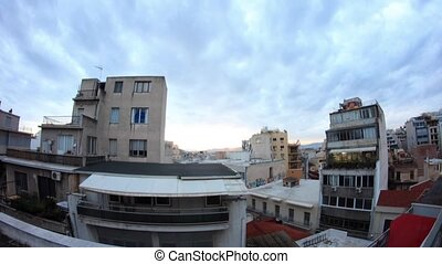 greek sunset - overview of Athens roofs at dusk
