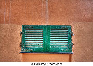 small window in an orange wall - small window in an orange...
