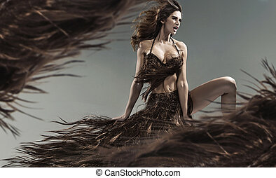 Alluring young brunette among the hair storm