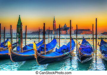 blue gondolas under a colorful sunset. Shot in Venice, Italy