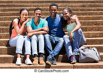 group of african university students sitting on steps
