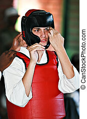 karate fighter - Young man preparing to fight at a martial...