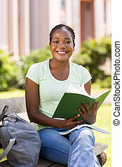 young college student studying outdoors - beautiful young...