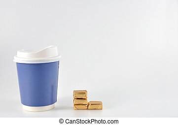 Small candies with take home paper coffee cup