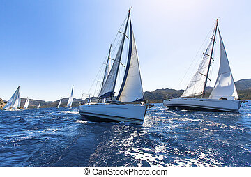 Sailing in the wind through the waves at the Aegean Sea in...